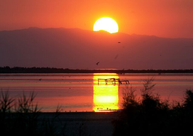 Setting sun is reflected on the surface of the Salton Sea in the Southern California desert