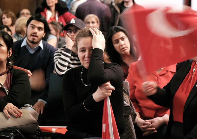 People react on election results during an election party of the Republican People's Party (Cumhuriyet Halk Partisi, CHP) in Berlin, on April 16, 2017