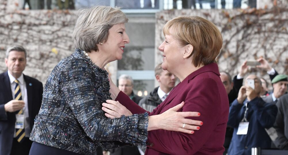 German Chancellor Angela Merkel (R) welcomes British Prime Minister Theresa May as she arrives for a meeting of the US President with European leaders on November 18, 2016 at the Chancellery in Berlin