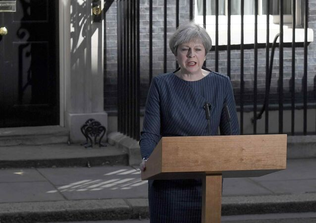 Britain's Prime Minister Theresa May speaks to the media outside 10 Downing Street, in central London, Britain April 18, 2017