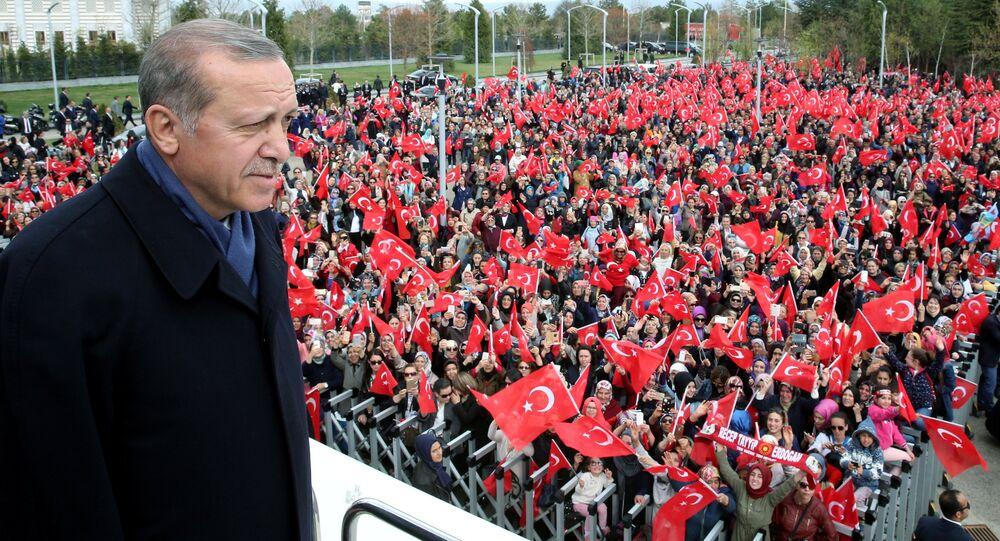Turkish President Tayyip Erdogan addresses his supporters upon his arrival at Esenboga Airport in Ankara, Turkey, April 17, 2017.
