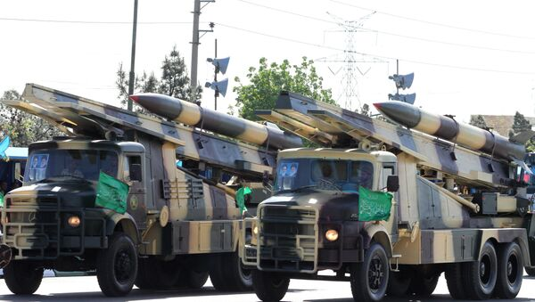 Iranian military trucks carry surface-to-air missiles during a parade on the occasion of the country's Army Day, on April 18, 2017, in Tehran - Sputnik International