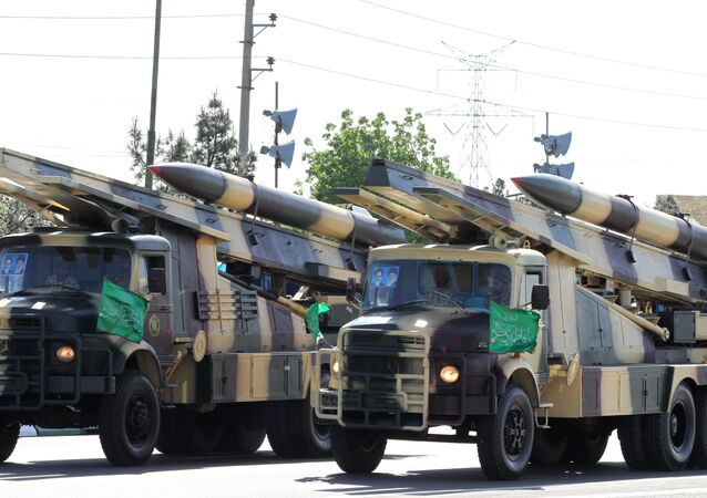 Iranian military trucks carry surface-to-air missiles during a parade on the occasion of the country's Army Day, on April 18, 2017, in Tehran