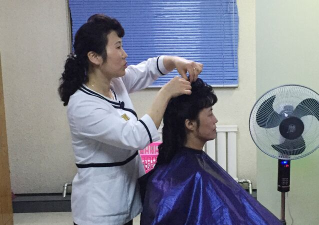 A woman in a hair salon which opened at one of the advanced industrial facilities in Pyongyang