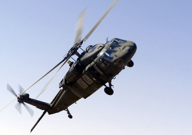 A picture taken 30 October 2000 shows an UH-60 Blackhawk helicopter flying near the Prince Sultan Air Base, Saudi Arabia