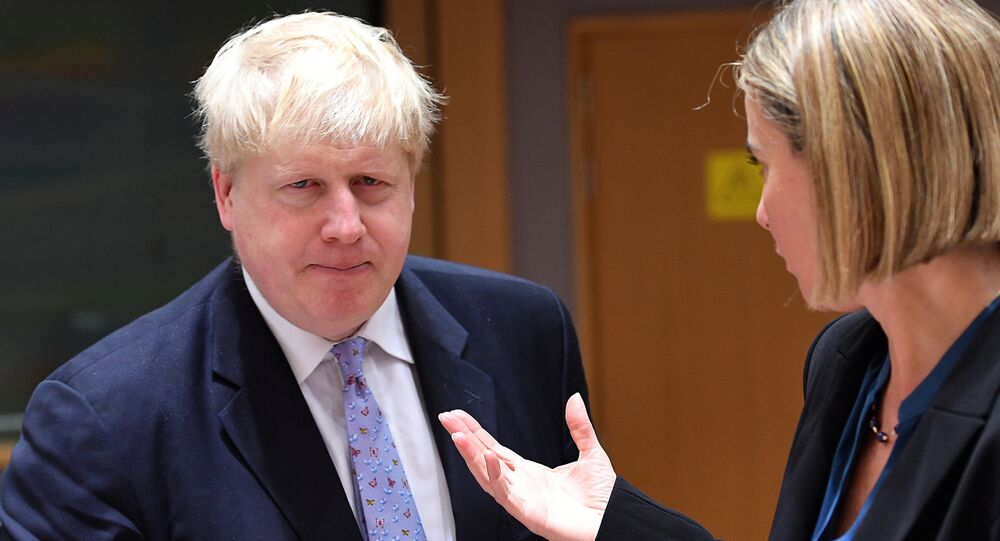 British foreign minister Boris Johnson (L) listens to EU foreign policy chief Federica Mogherini during an EU foreign ministers meeting at the European Council, in Brussels, on January 16, 2017