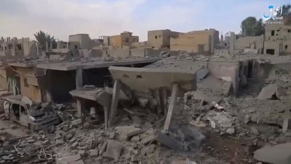 A still image taken from a video released on the internet by Islamic State-affiliated Amaq News Agency, on April 18, 2017, purports to show the aftermath, said to be in al-Bukamal town, in Deir al-Zor province, after air strikes thought to have been directed by planes from a U.S.-led military coalition, Syria - Sputnik International