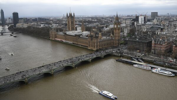 The Palace of Westminster, comprising the House of Commons and the House of Lords, wchich together make up the Houses of Parliament, are pictured on the banks of the River Thames alongside Westminster Bridge in central London on March 29, 2017 - Sputnik International