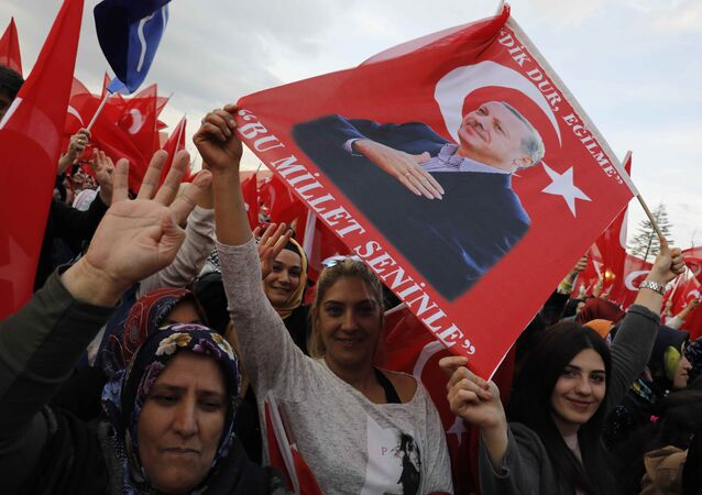 Supporters of Turkish President Tayyip Erdogan wave national flags as they wait for his arrival at the Presidential Palace in Ankara, Turkey, April 17, 2017