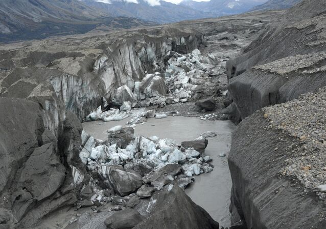close-up view of the ice-walled canyon at the terminus of the Kaskawulsh Glacier, with recently collapsed ice blocks.