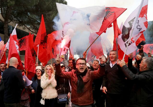 Supporters of the Albanian opposition shout anti-Government slogans as they protest in front of the government building in Tirana on February 18, 2017