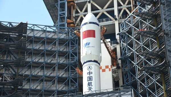 Long March-7 rocket and Tianzhou-1 cargo spacecraft are seen as they are transferred to a launching spot in Wenchang, Hainan province, China, April 17, 2017 - Sputnik International