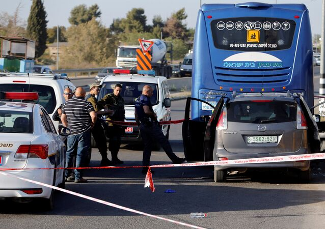 An Israeli policeman inspects the scene of a Palestinian car ramming attack at the Gush Etzion Junction, south of the West Bank city of Bethlehem April 19, 2017