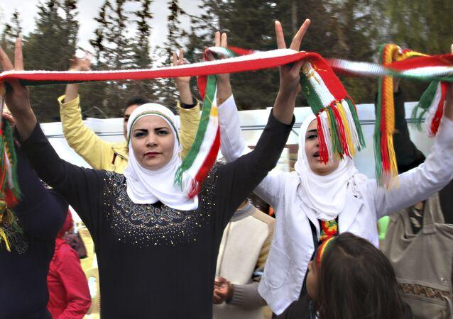 Syrian Kurds dance to celebrate Nowruz, the Kurdish new year, in Damascus, Syria. (File)