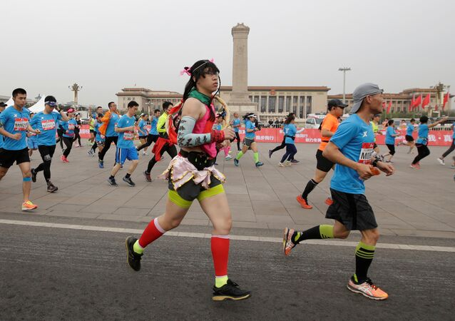 Participants run past Tiananmen Square during the annual Beijing International Running Festival and Beijing Half Marathon, in Beijing China April 16, 2017.