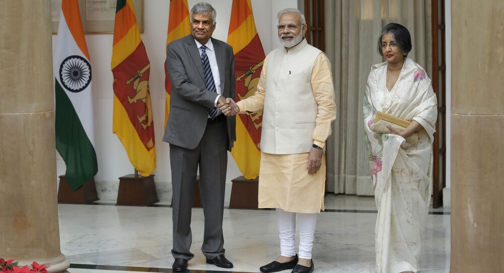 Indian Prime Minister Narendra Modi, center, poses with his Sri Lankan counterpart Ranil Wickremesinghe for a photo next to his wife Maitree Wickremasinghe in New Delhi, India, Wednesday, Oct. 5, 2016.
