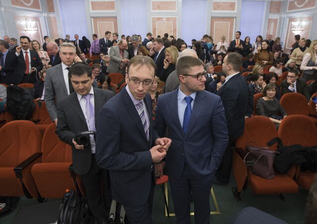 Members of Jehovah's Witnesses wait in a court room in Moscow, Russia