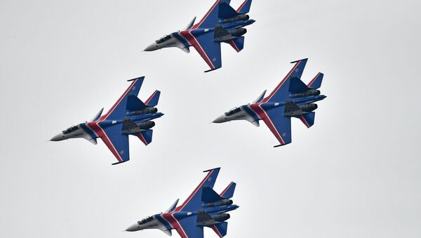 Su-30SM multipurpose fighter jets of the Russian Knights aerobatic display team during a rehearsal of the Victory Day parade air show. - Sputnik International