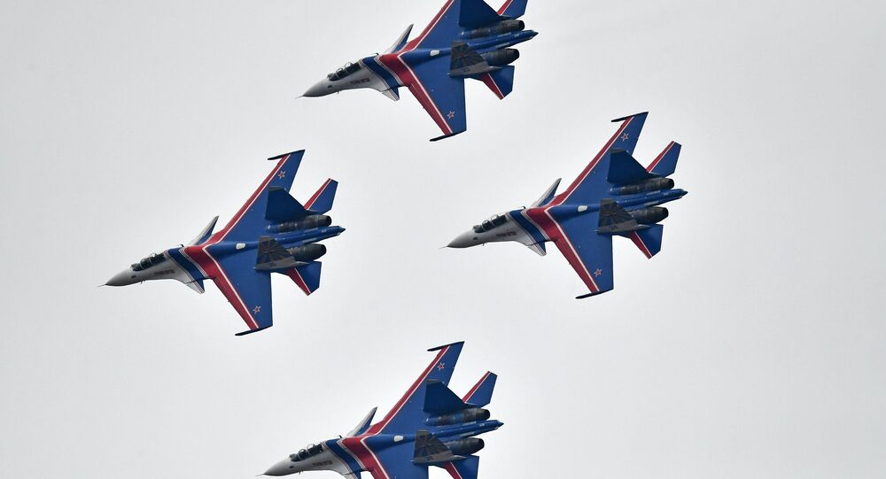 Su-30SM multipurpose fighter jets of the Russian Knights aerobatic display team during a rehearsal of the Victory Day parade air show.