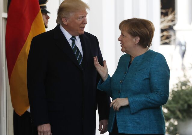 President Donald Trump greets German Chancellor Angela Merkel outside the West Wing of the White House in Washington, Friday, March 17, 2017