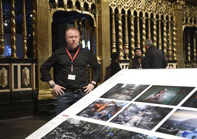 Valery Melnikov, Sputnik photojournalist and winner of multiple leading international photography contests at 2017 World Press Photo exhibition.