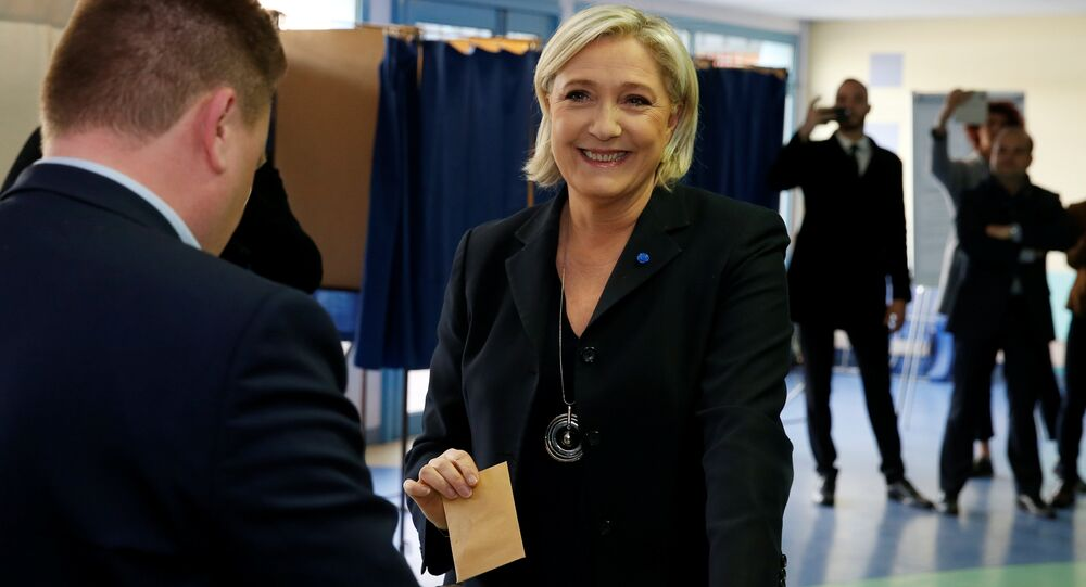 Marine Le Pen, French National Front (FN) political party leader and candidate for French 2017 presidential election, casts her ballot in the first round of 2017 French presidential election at a polling station in Henin-Beaumont, northern France, April 23, 2017.