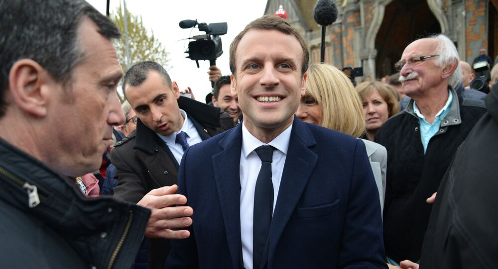 Emmanuel Macron, leader of En Marche! movement, center, is seen here in Le Touquet-Paris-Plage in the Pas-de-Calais department during the first round of the French presidential elections.