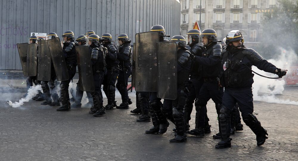 Riot police officers take position during a protest in Paris