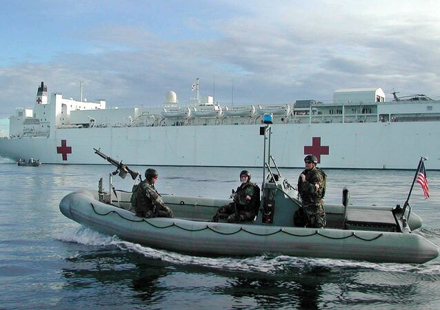 Members of the US Navy SEALS on a rubber boat patrol around the US Navy hospital ship the USNS Mercy