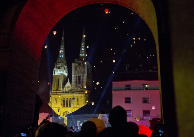 Zagreb cathedral is seen in background as paper lanterns are released as a part of Christmas festivities in Zagreb, Croatia