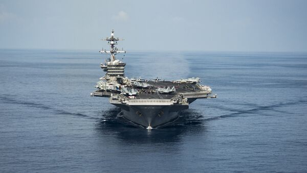The aircraft carrier USS Carl Vinson transits the South China Sea while conducting flight operations on April 9, 2017. - Sputnik International