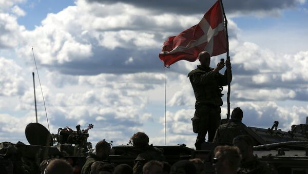 Danish soldiers during a military exercise ' Saber Strike 2014 ' at the Rukla military base some 120 km. (75 miles) west of the capital Vilnius, Lithuania, Tuesday, June 17, 2014. - Sputnik International