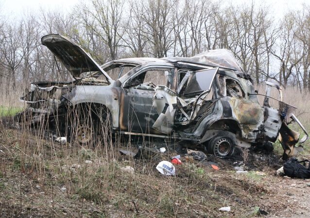The site of the explosion of a car of the OSCE's Special Monitoring Mission to Ukraine, near the village of Prishib in the Lugansk region.