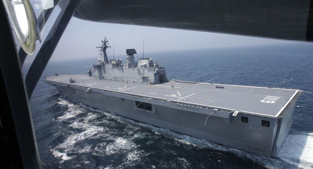 The South Korean navy's 14,000 ton-class large-deck landing ship Dokdo sails through the Yellow Sea of South Korea during military drills, Thursday, Aug. 5, 2010.