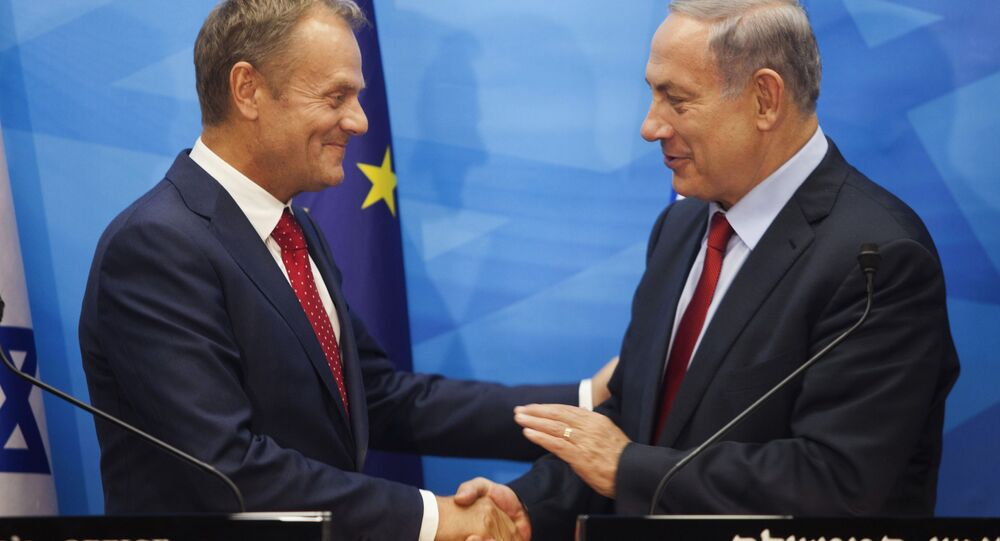 Israeli Prime Minister Benjamin Netanyahu, right, shakes hands with European Council President Donald Tusk during their meeting at the prime minister's office in Jerusalem on Tuesday, Sept. 8, 2015. Tusk is on an official visit to the region.