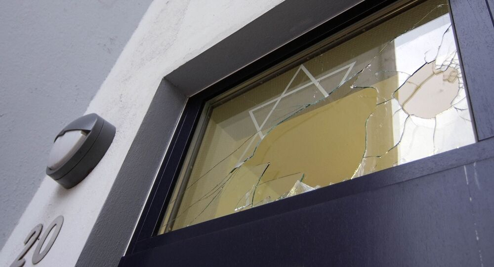 A broken window is seen at the center of the Jewish community in Rostock, northern Germany (File)