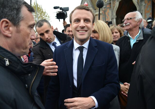 Emmanuel Macron, leader of En Marche! movement, center, is seen here in Le Touquet-Paris-Plage in the Pas-de-Calais department during the first round of the French presidential elections