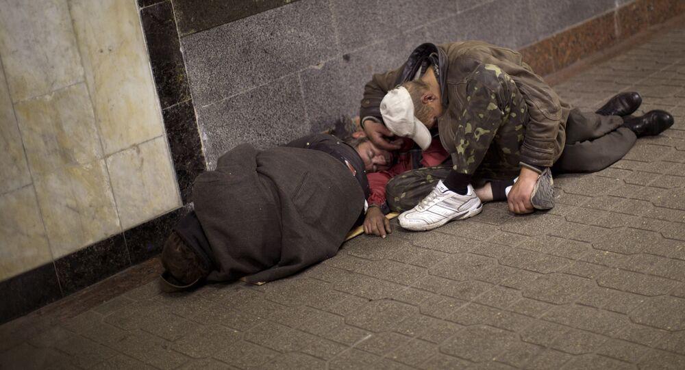 Homeless men sleep inside an underground shopping mall in central Kiev, Ukraine