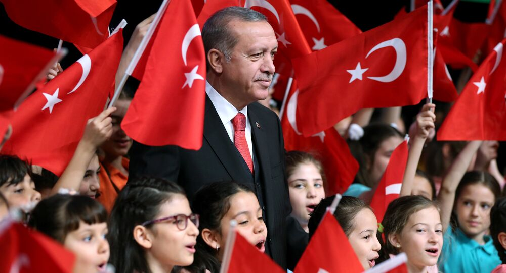 Turkish President Tayyip Erdogan poses with children during a ceremony to mark the National Sovereignty and Children's Day at the Presidential Palace in Ankara, Turkey, April 23, 2017.