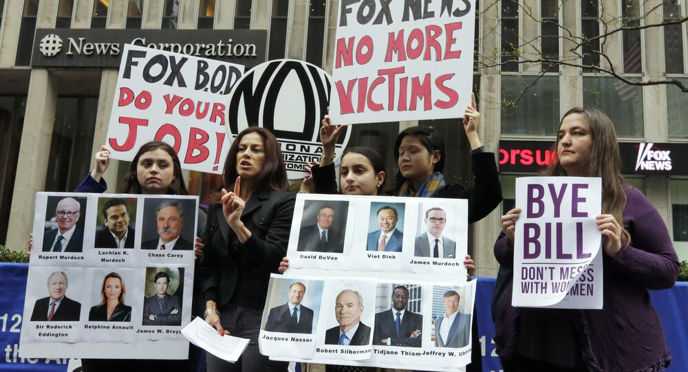 Sonia Ossorio, second left, president of the National Organization for Women New York, speaks outside the News Corporation headquarters, in New York, Thursday, April 20, 2017, a day after Fox News Channel's Bill O'Reilly was fired.