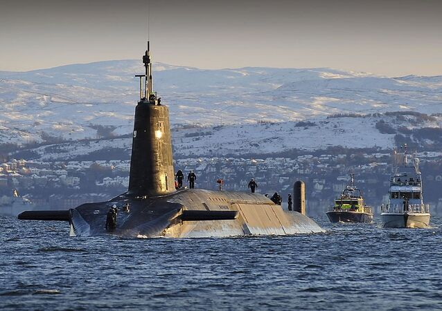 Nuclear submarine HMS Vanguard arrives back at HM Naval Base Clyde, Faslane, Scotland following a patrol