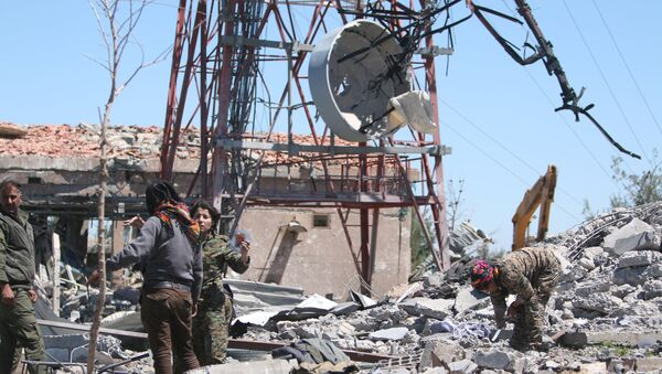 Fighters from the Kurdish People's Protection Units (YPG) inspect the damage at their headquarters after it was hit by Turkish airstrikes in Mount Karachok near Malikiya, Syria April 25, 2017 - Sputnik International