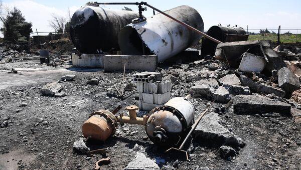 Aftermath of US missile attack on Ash Sha'irat airbase in Syria. File photo - Sputnik International