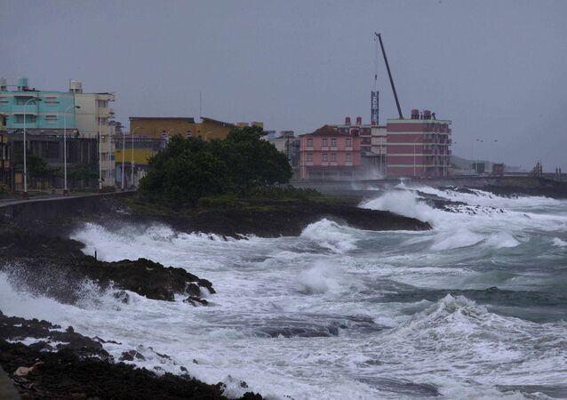 Waves crash against a seawall in Baracoa, Cuba, Tuesday, Oct. 4, 2016