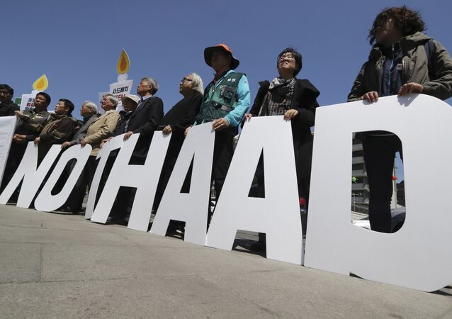 Protesters hold letters reading NO THAAD during a rally to oppose a plan to deploy an advanced U.S. missile defense system called Terminal High-Altitude Area Defense, or THAAD, near U.S. Embassy in Seoul, South Korea, Wednesday, April 26, 2017