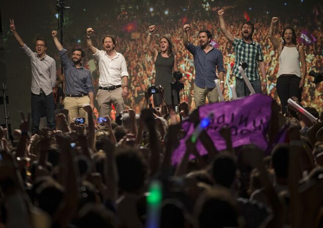 Spain's Podemos coalition party leader Pablo Iglesias, third left, shouts slogans with other party leaders following the results of the general election, in Madrid, Sunday, June 26, 2016