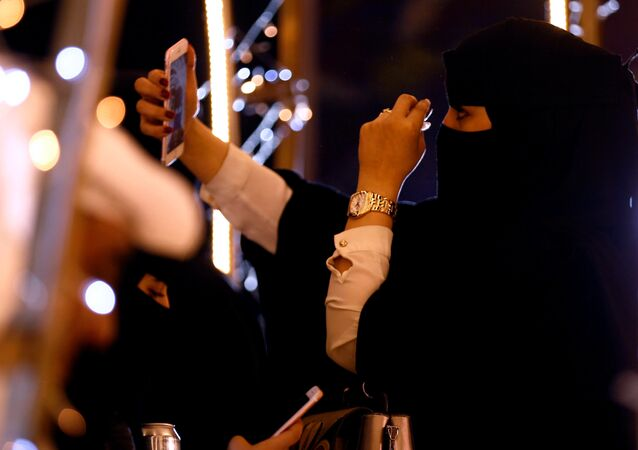 A woman takes a selfie during during celebrations for naming Abha as 'Capital of Arab Tourism', in Abha, Saudi Arabia April 18, 2017. Picture taken April 18, 2017.
