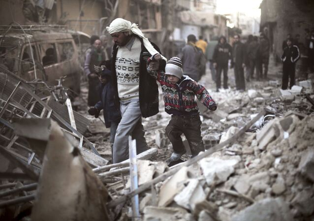 Man walks with a pair of children in hand hand through the rubble in Eastern Ghouta, Syria (File)