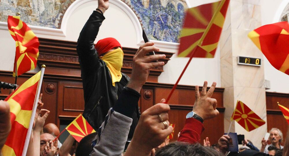 Protesters entered Macedonia's parliament after the governing Social Democrats and ethnic Albanian parties voted to elect an Albanian as parliament speaker in Skopje. Macedonia April 27, 2017