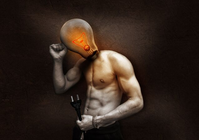 Man with lightbulb for head holding a cable